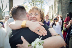 mother hugging new son-in-law