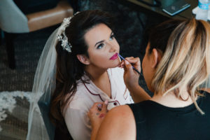 bride getting her make-up at hotel