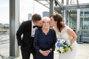 bride and groom kissing grandmother