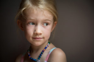 young girl photographed by window light
