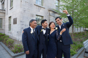 groom and family laughing